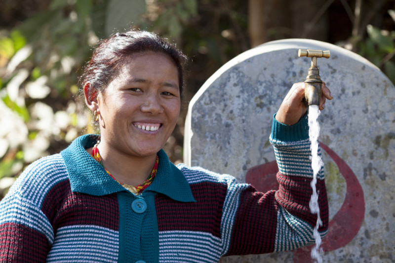 Sindhupalchok, Nepal: Muna Tamang Giri near her home in Sindhupalchok where Oxfam rehabilitated water and sanitation facilities as part of the Earthquake response. Credit: Abbie Trayler-Smith/Oxfam