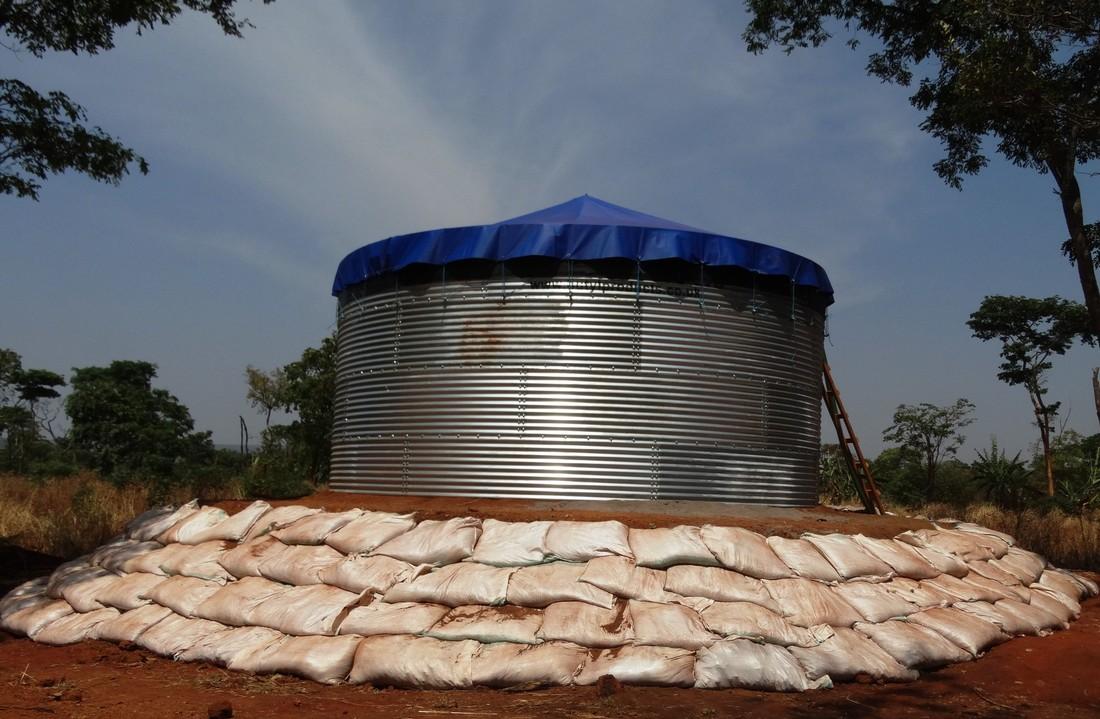 An Oxfam water tank under construction, Nduta camp, Tanzania