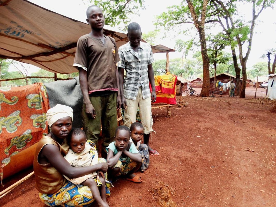 A Burundian refugee family wait to move camps in Tanzania