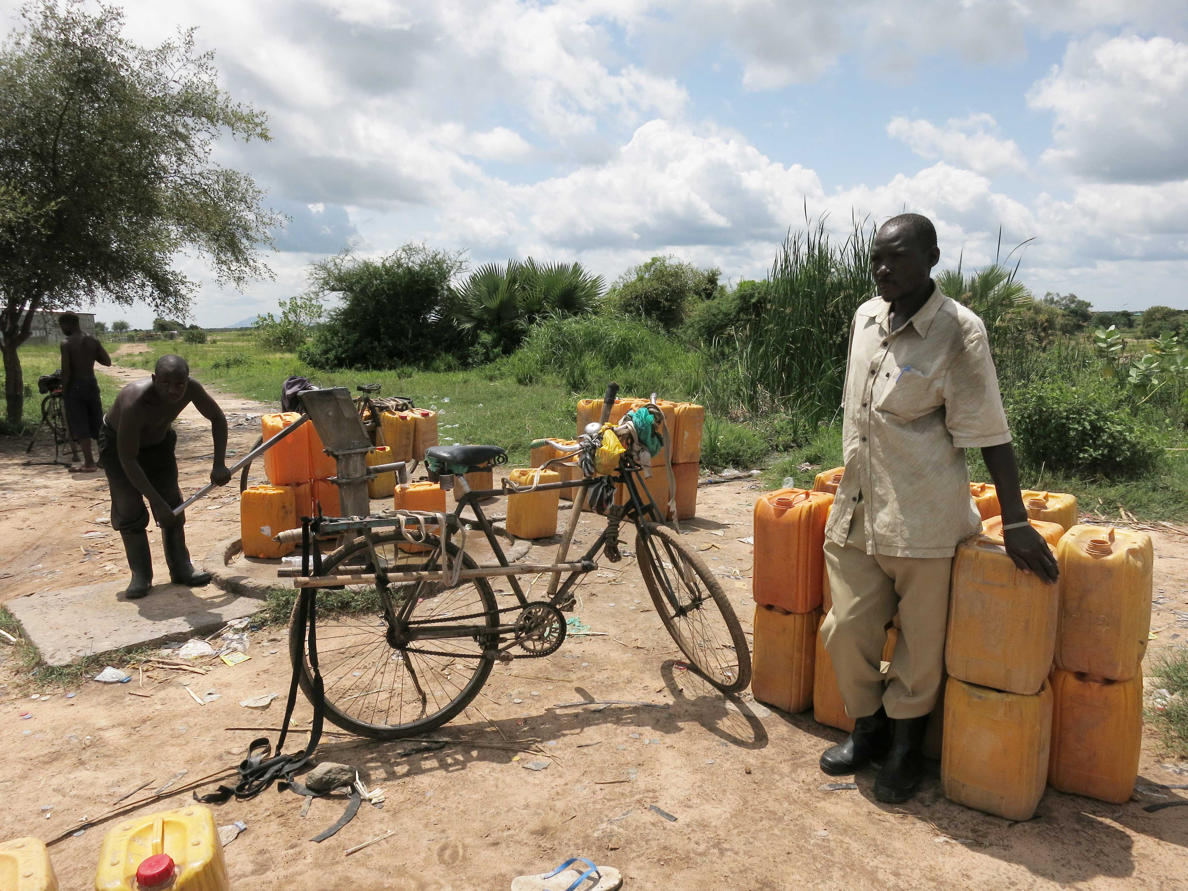 Moses is a water seller (bicycle)  in Gumba, South Sudan. Credit: Stella Madete/Oxfam
