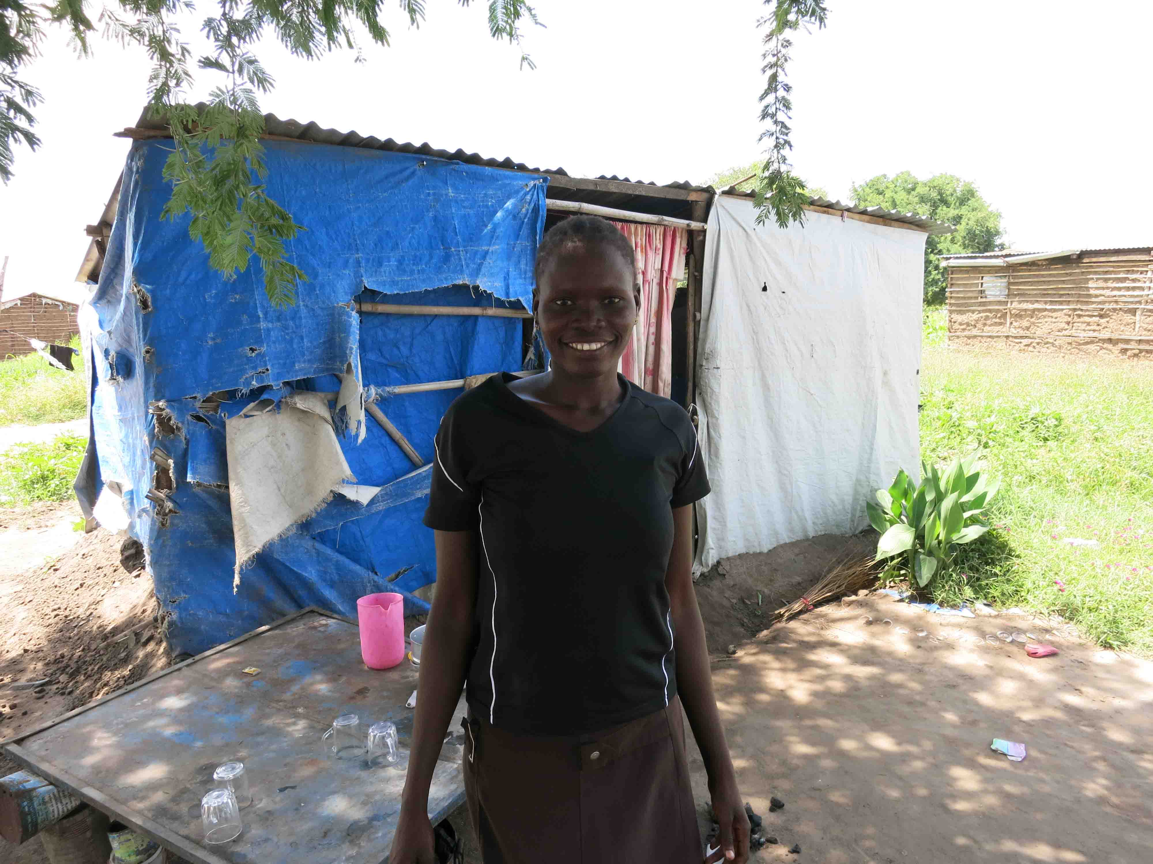 Sura outside her home in Gudele. Credit: Stella Madete/Oxfam