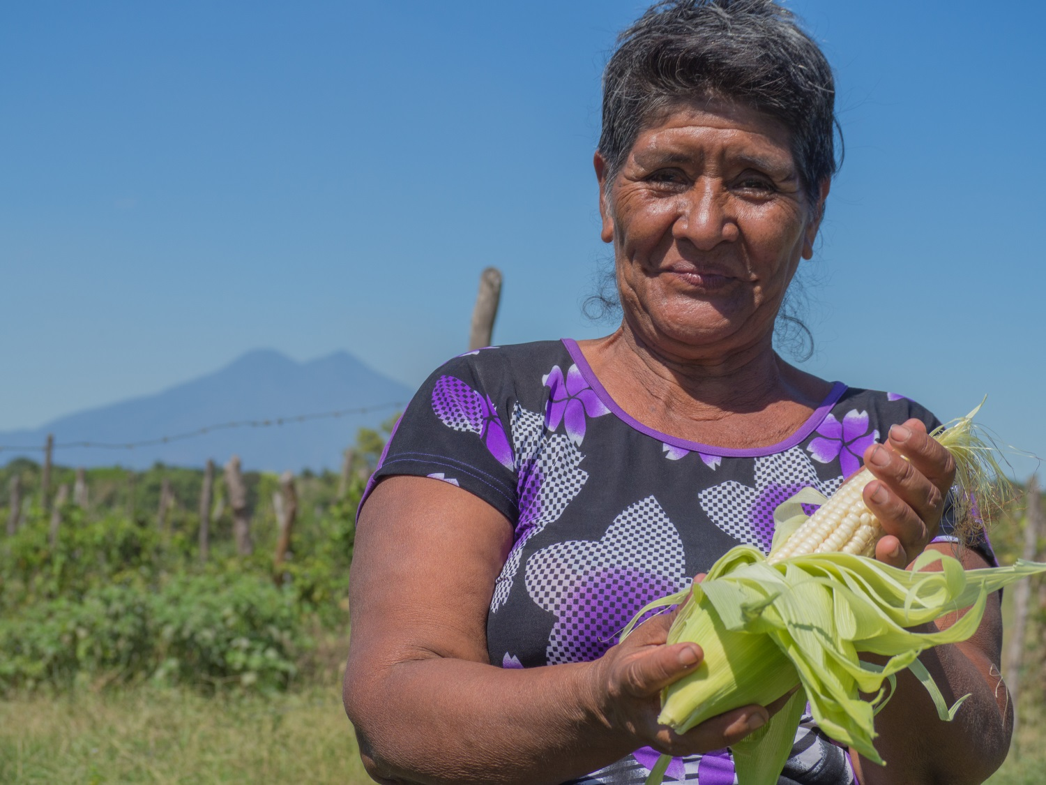Farmer Flor Aquino displays corn grown on a community plot in El Ranchón, as part of a program focused on building resilience to drought. While the country is reeling from the effects of El Niño
