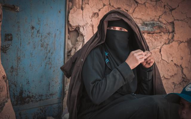 A mother explains that she wouldn't accept getting her daugher married if their conditions were better than the misery the family is living. Photo credit: Sami M Jassar/Oxfam