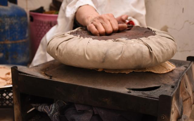 Najwa making bread, Harasta, Eastern Ghouta, Rural Damascus.