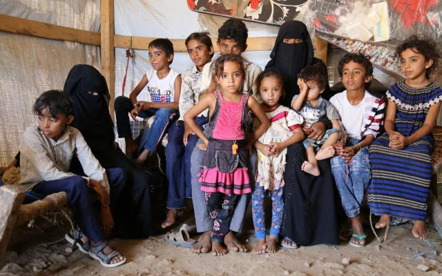 Hind Ahmed with her ten children in their temporary tent, Bani Thawab sub-district, Abs District Hajjah Gov.   Credit: Oxfam/Ahmed Al-Fadeel