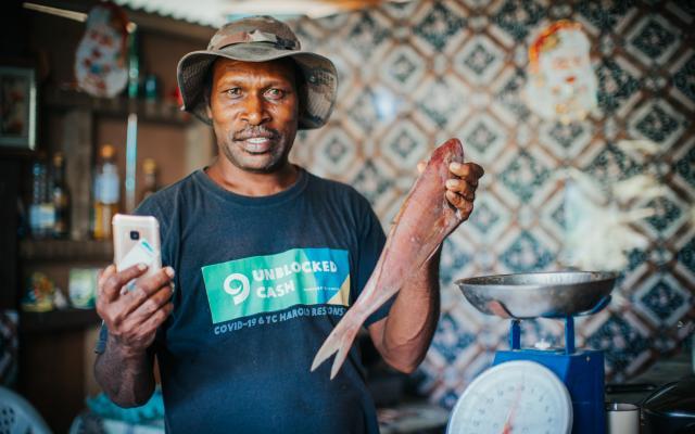 A fish vendor in Vanuatu participating in the UnBlocked Cash project