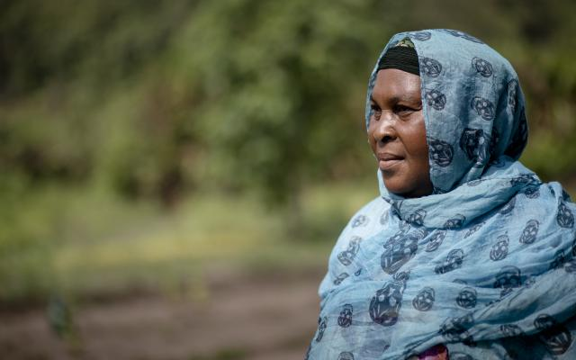 Housseina, president of a gardening association supported by Oxfam, poses for a portrait in the collective field she shares with other muslim women in Bangassou, the Central African Republic.