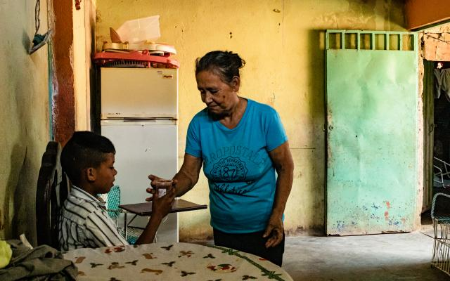 When her husband emigrated, Clavel* stayed in charge of her 11-year-old grandson. On many occasions she has had to stop eating in order to feed him.
