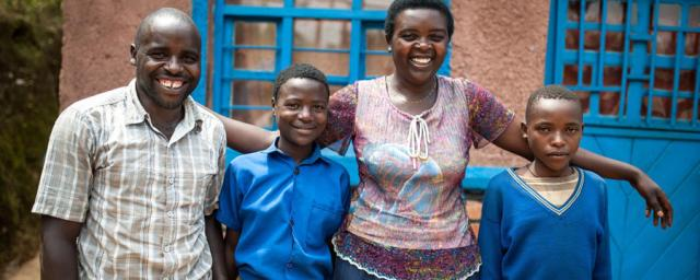 Christine Manirafasha stands with her husband Claude and 2 children, 12 year old Marie Liliane* (daughter) and 12 year old Emmanuel* (son) stand outside their home in Gakenke district, Northern Rwanda.Aurelie Marrier d'Unienville/Oxfam