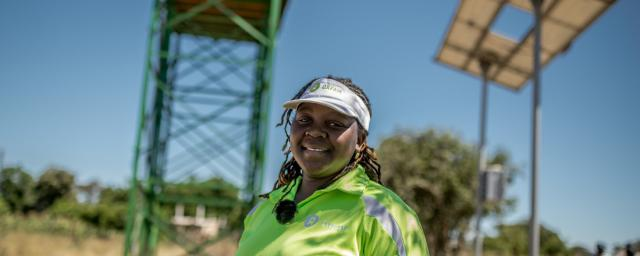 Takudzwa, 33yrs, an Oxfam WASH Engineer is photographed at a Oxfam funded solar piped water system in Somertone village, Masvingo District, Zimbabwe. The system will supply water to a local school and clinic as well as many families in the local community.