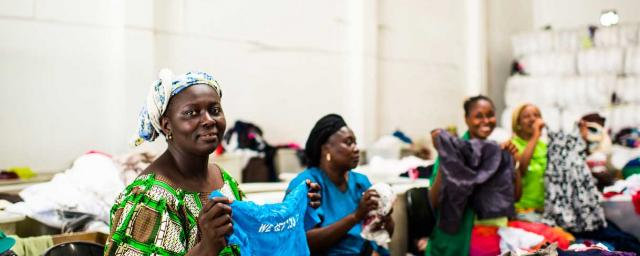 Women working at the Frip Ethique sorting warehouse in Dakar, Senegal. Credit: Rachel Manns / Oxfam