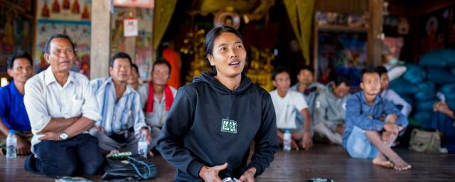 Hong Rany, 26, participates in a workshop on Cambodia's fishery regulations at the pagoda in Ksach Leav village. Credit: Savann Oeurm/Oxfam America