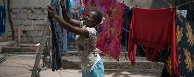 Tabitha Mwikali, 36, a domestic worker hanging clothes for her employer in Eastleigh, Nairobi, Kenya. Credit: Allan Gichigi/Oxfam