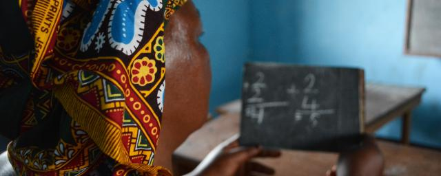 A woman is learning Arithmetic for the first time of her life, during a literacy lesson at the Women's Home in Bria. Credit: Aurélie Godet, Oxfam
