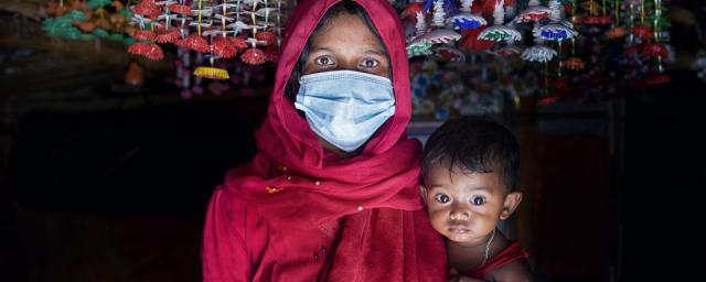 Nur Jahan* with her daughter Ismat* in her tent, Rohingya refugee camp, Cox's Bazar, Bangladesh