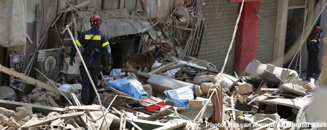 French fireman and a rescue dog search in the rubble of a building after the Tuesday explosion at the seaport of Beirut, in Beirut, Lebanon.