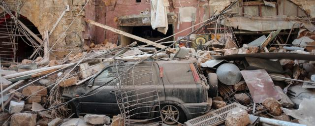 Rubble and debris sit on a damaged automobile on a residential street in Beirut, Lebanon, on Wednesday, Aug. 5.