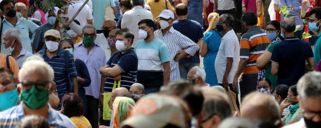 People wearing protective face masks wait to receive a vaccine for the coronavirus disease (COVID-19) at a vaccination centre in Mumbai, India, April 26, 2021.