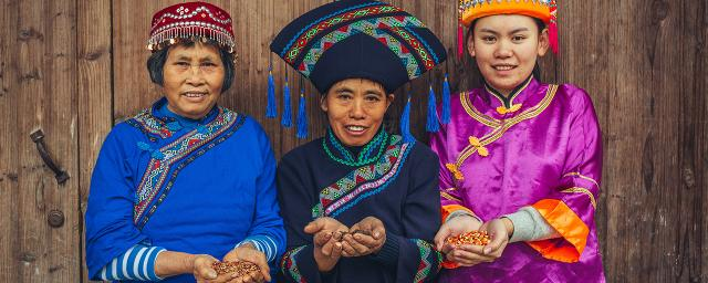 Members of Mashan Rongyan Farmers' Cooperative proudly showing their seeds during the pandemic, Yunnan, China.