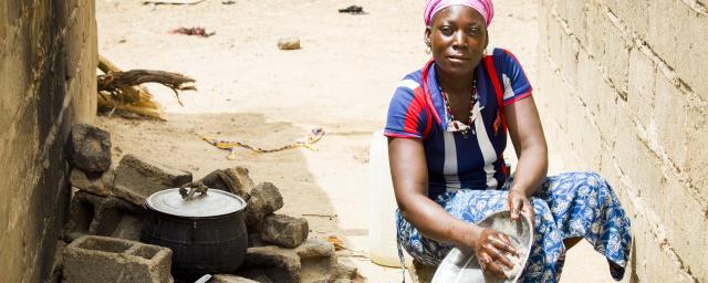 Zoré Fatimata in front of her house, Burkina Faso