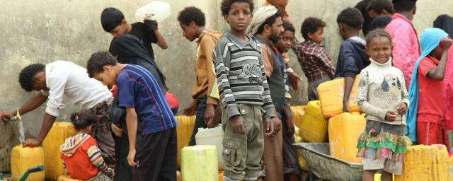 Displaced children in Yemen wait and collect Water