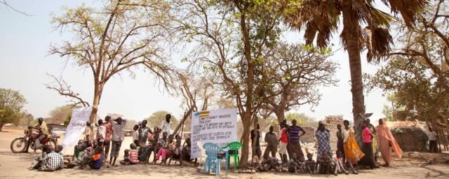Residents of Rumbek, the capital of Lake state, South Sudan, are gathering under some trees for a public forum