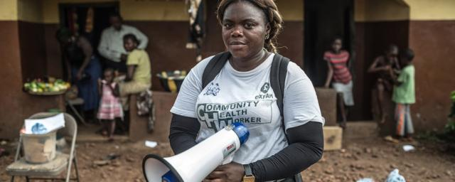 Aminata is one of Oxfam's Community Health Workers in Sierra Leone. She teaches the community about the signs and symptoms of Ebola, about how to prevent it and what to do if a family member becomes infected. Photo: Pablo Tosco/Oxfam