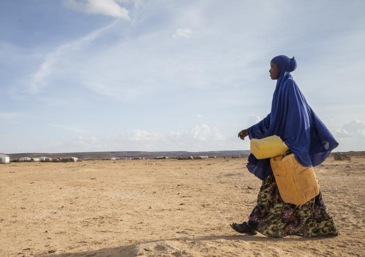 Ayan on her way to fetch water from a water well, in Somaliland.