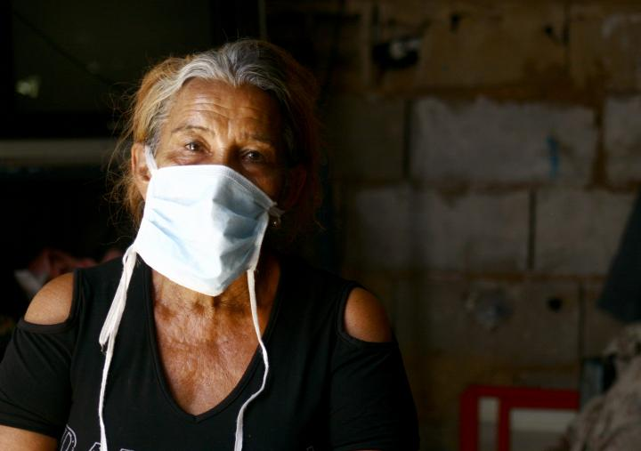 Nuvis is 64 years old. She has been selling coffee and cigarettes in front of the Port of Maracaibo, Venezuela.