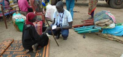 A DRC staff member interviews a woman recently arrived from Khartoum, Sudan. Photo by Gatluak Nen Chan/DRC