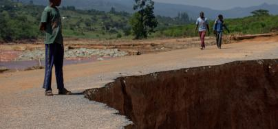 A boy looks at a section of road that was washed away in the flooding caused by Cyclone Idai, near Chimanimani, Zimbabwe, pictured on 29 March 2019. Credit: Philip Hatcher-Moore/Oxfam.