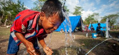 Palu, Indonesia: Arif washes his face with clean water pumped from an Oxfam Skyhydrant water filter. Credit: Keith Parsons/Oxfam