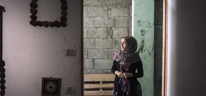 Aya Kishko opened a carpentry workshop and developed an environmental friendly method to create furniture by recycling used wood pallets that comes into Gaza as packaging for the few goods that are allowed in. Credit: Lorenzo Tugnoli/ Oxfam/ Contrasto
