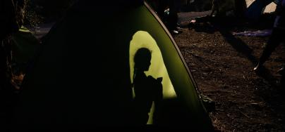 A child in the 'Olive Grove' section of the Moria 'hotspot' camp in Lesvos, Greece. Giorgos Moutafis/Oxfam
