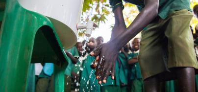 Students of the Primary Complex School in Gondokoro island, South Sudan, attend an awareness event organised by Oxfam to prevent cholera and inform about good hygienic practices.