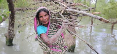 Nurjahan (45) collecting wood to sell for food after cyclone Bulbul. Gabura, Shamnagar. Photo: Fabeha Monir/Oxfam