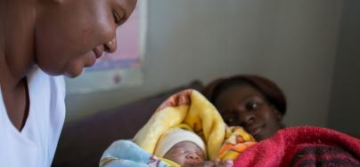 Head nurse Sibongile, 29, assists Viola, 22 with her birth