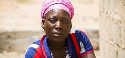 Zoré Fatimata in front of her house, in Burkina Faso.
