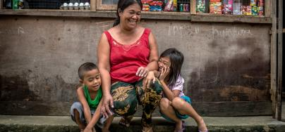 Annabelle Alemania, 42yrs, stands with 2 of her 7 children infront of her small variety store (in her home) in the Guadalupe Resettlement Site, Tacloban North, Philippines