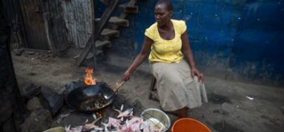 Zipporah Kwamboka preparing fish for her business in Mukuru, Nairobi, Kenya