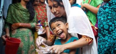 A teenage volunteer conducts hygiene promotion classes with her peers, Bangladesh