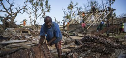 Wolda Edward, helps cleaning his neighbour's after Cyclone Pam.