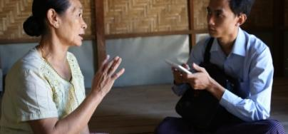 A displaced woman discusses her story in Myanmar (Burma)