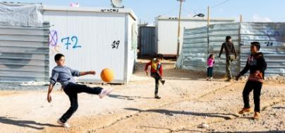 Syrian children play football in Za'atari refugee camp, Lebanon
