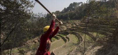 A women participates in an Oxfam cash for work program after the Nepal Earthquake