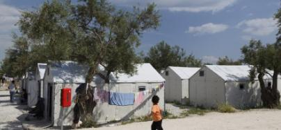 A young child walks through Kara Tepe refugee camp, Greece.