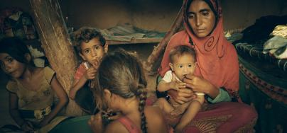 Mona, who fled the frontlines three years ago, can give only bread and tea to her children, the youngest of whom is malnourished. Photo: Sami Jassar/Oxfam in Yemen.