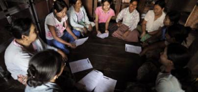 A group of women discuss in a village in Myanmar's Ayeyarwaddy Delta. Photo: Kaung Htet/Oxfam
