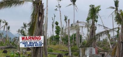 A government sign highlighting the newly designated 'no build zone' along the coast in Candahue, Leyte. Photo: Laura Eldon/Oxfam