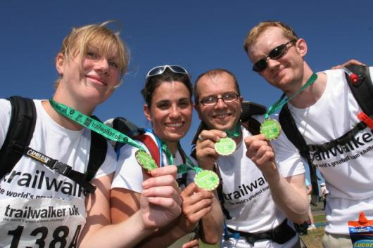 Trailwalker team show completion medals